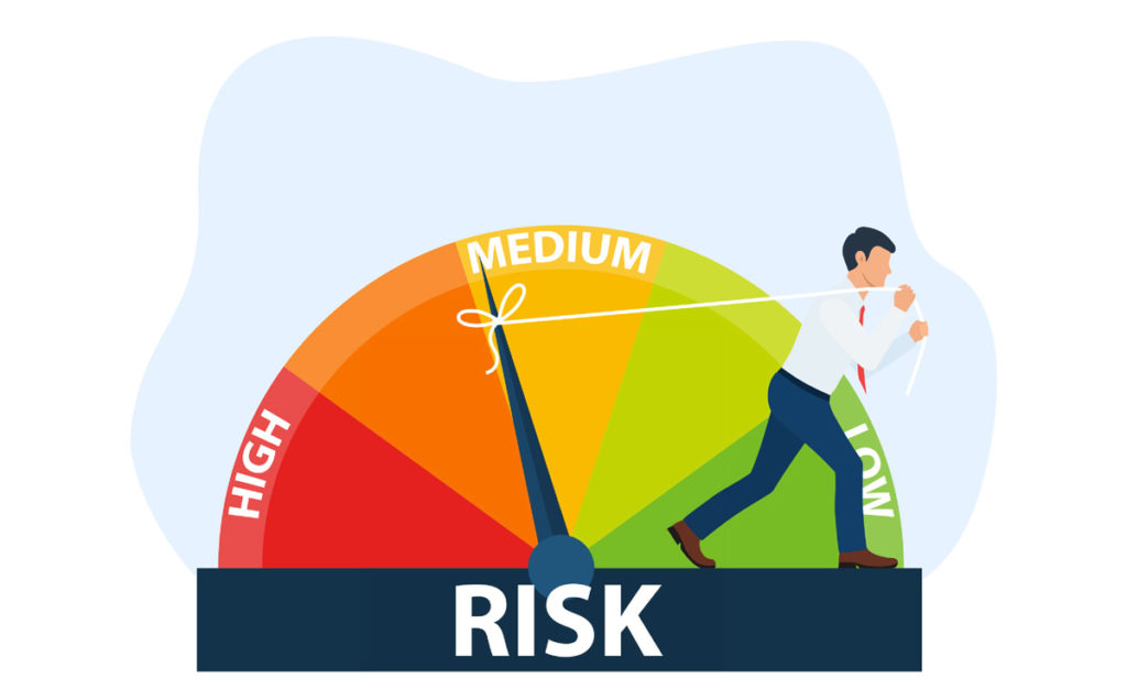 man pulling a needle of a risk management gauge from a higher risk to a lower risk level